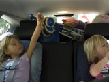 Kids Play During a Long Car Ride, Pittsburgh, Pennsylvania Photographic Print by Stacy Gold