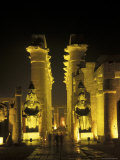 Luxor Temple Entrance with Ramses II Statues at Night in Luxor, Egypt Photographic Print by Richard Nowitz