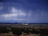 Rain Pores Down on the Desert Landscape in New Mexico Photographic Print by Stacy Gold