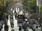 Cyclists and Pedestrians on a Busy Guangzhou Street, China Photographic Print by James L. Stanfield