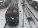 Danish Train Leaving Station in Snowstorm, Copenhagen, Denmark Photographic Print by  Brimberg & Coulson