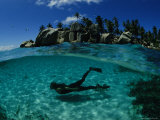 Diver Swims in the Beautiful Water Off the Isle de Coco in the Seychelles Photographic Print by Bill Curtsinger