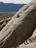 Jeep Drives Down a Slick Rock Formation Called Lion&#39;s Back, Utah Photographic Print by James P. Blair