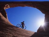 Mountain Biker Stands under an Arch Photographic Print by Bill Hatcher