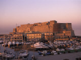 Old Fortress and Harbour at Sunset in Naples, Italy Photographic Print by Richard Nowitz
