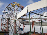 Ferris Wheel and Merry Go Round Sit Idle at a Nicaraguan Fairground Photographic Print by David Evans