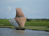 Fishermen Sail Upstream Along the Bank of the Meghna River Photographic Print by James P. Blair