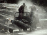 Jeep Full of Innocent Onlookers is Sprayed with Water During the Water Festival Photographic Print by James L. Stanfield