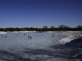 People Ice Skate on a Frozen Lake in Wisconsin Photographic Print by Stacy Gold