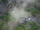 Float Plane against Granite Cliff, Alaska Photographic Print by Ralph Lee Hopkins