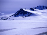 Mountain Tops Peek Out over Harding Ice Field, Alaska Photographic Print by Stacy Gold