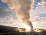 Old Faithful Geyser Erupts at Sunrise, Yellowstone Photographic Print by Michael S. Lewis