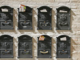 Mailboxes Lined on a Stone Wall, Ravenna, Italy Photographic Print by Gina Martin