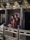 Monks on a Balcony Taking a Break from their Studies, Qinghai, China Photographic Print by David Evans