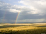 Rainbows Form over the Serengeti Plains, Tanzania Photographic Print by Michael Fay