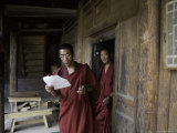 Monks at a Doorway Taking a Break from their Studies, Qinghai, China Photographic Print by David Evans