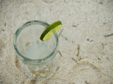 Lemonade, Lime and Straw Sitting on Sandy Beach as Seen from Above, Ambergris Caye, Belize Photographic Print by James Forte