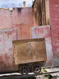 Rusty Old Silver Mining Car on Tracks and Distressed Pink Buildings, Guanajuato, Mexico Photographic Print by David Evans