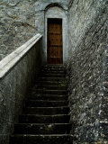 Narrow Stairway to a Wooden Door Inside the Grounds at Brolio Castle, Tuscany, Italy Photographic Print by Todd Gipstein