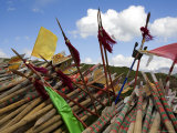 Prayer Flags from a Recently Dismantled Shrine, Qinghai, China Photographic Print by David Evans