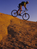 Male Mountain Biking Slickrock in Wyoming Photographic Print by Bobby Model