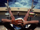 Man Takes a Break from Fishing on a Boat in the Bahamas Photographic Print by Kenneth Garrett