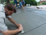 Men Smooth a Concrete Driveway Photographic Print by Joel Sartore