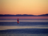 Sailboat Coming into Shore at Sunset with Islands in the Background, California Photographic Print by James Forte