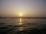 Peaceful Scene of the Holy Ganges River Aka the Ganga River at Dawn Photographic Print by Jason Edwards