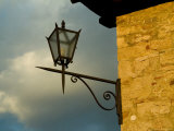 Lantern on the Corner of a Tuscan Villa, Tuscany, Italy Photographic Print by Todd Gipstein