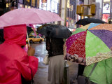 Pedestrians with Umbrella in Times Square on a Rainy Afternoon Photographic Print by Ira Block