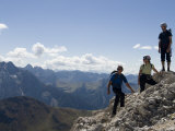 Mountaineers Stand Onto of a Summit in the Dolomites, Italy Photographic Print by Bill Hatcher