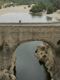 Pedestrians on the 12th Century Pont Diable over the Herault River, France Photographic Print by Bill Hatcher