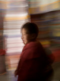 Panned View of a Novice Buddhist Monk, Qinghai, China Photographic Print by David Evans