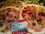 Pizza Displayed for Sale at a Market in Venice, Italy Photographic Print by Todd Gipstein
