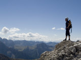 Rock Climber Stands on a Mountain Summit in the Dolomites, Italy Photographic Print by Bill Hatcher