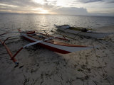 Outrigger Fishing Boats Pulled Up on the Beach on Malapascua Island, Philippines Photographic Print by Tim Laman