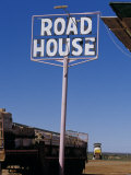 Pink Roadhouse Sign in an Isolated Outback Settlement Town, Australia Photographic Print by Jason Edwards