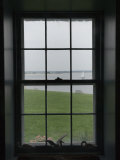 Looking Through the Window of Historic Home to a Sailboat on the Sound, Stonington, Connecticut Photographic Print by Todd Gipstein