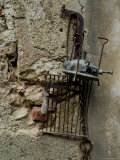 Rusted Antiques Hanging on a Stone Wall, Asolo, Italy Photographic Print by Todd Gipstein