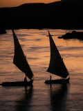 Sunset on the Nile River with Silhouetted Boats in Egypt Photographic Print by Richard Nowitz