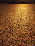 The Sun Reflects Off This Parched Lake Bed Photographic Print by Bill Hatcher