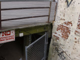 No Trespassing Sign under the Boardwalk at Coney Island, Brooklyn, New York Photographic Print by Todd Gipstein