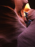 Man and Woman Canyoneering in a Rock Rock Slot Canyon Photographic Print by Kate Thompson