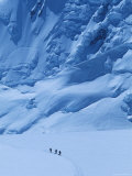 Three People Skiing Up the Kahiltna Glacier on Denali, Alaska Photographic Print by Bill Hatcher