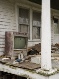 Ruined Old Television and Debris on Porch of an Abandoned House Fotoprint van David Evans