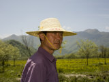 Man in a Straw Hat in Chinese Countryside, Dajuhu, China Photographic Print by David Evans