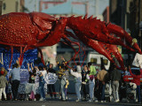 Louisianans Revel Beneath a Giant Crayfish Mardi Gras Float, New Orleans Photographic Print by Joel Sartore