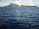 Sunrise View of Bora Bora Island from the Sea Photographic Print by Tim Laman
