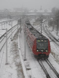 One Red Train on Snow Day, Copenhagen, Denmark Photographic Print by  Brimberg & Coulson